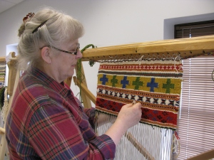 "Melba working on her banded ""West Coast"" style weaving"