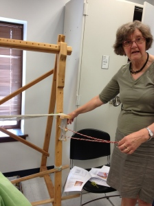 Marta demonstrating how to make a header for putting the warp on the loom