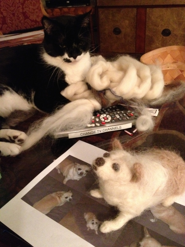 Guy supervises the felting process.  Note the sheet of photos below the in-process animal.